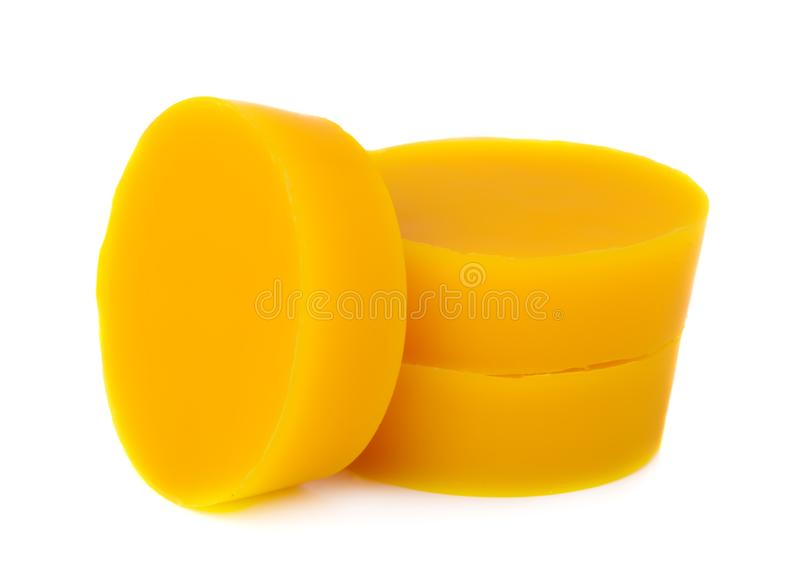 Pieces of natural beeswax are on a white background. Beekeeping products. Apitherapy. stock photo