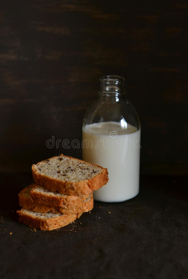 Pieces nut cake and a bottle of milk royalty free stock images