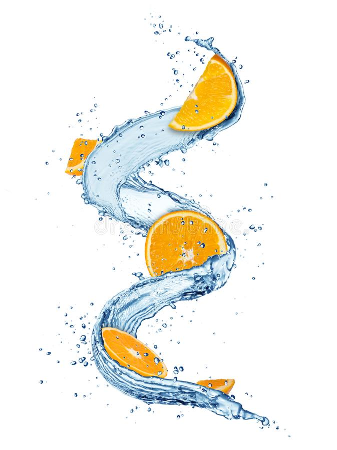 Pieces of orange fruit in water splashes, isolated on white back stock image