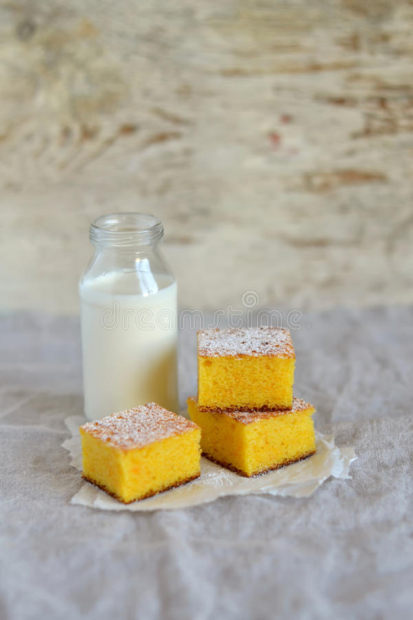 Pieces of pumpkin cake and a bottle of milk royalty free stock images