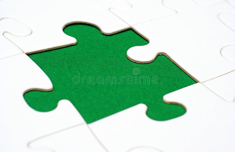 Pieces of a puzzle royalty free stock photography