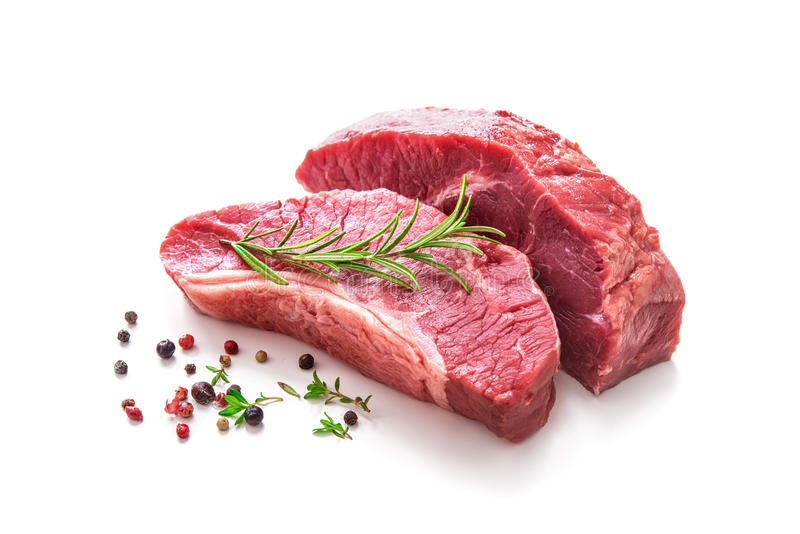 Pieces of raw roast beef meat with ingredients royalty free stock photo