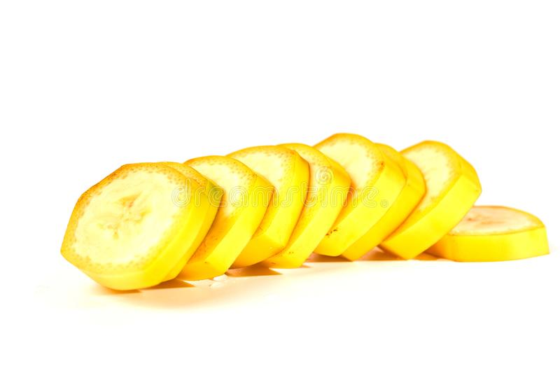 Pieces of ripe banana isolated on white background.  royalty free stock photos