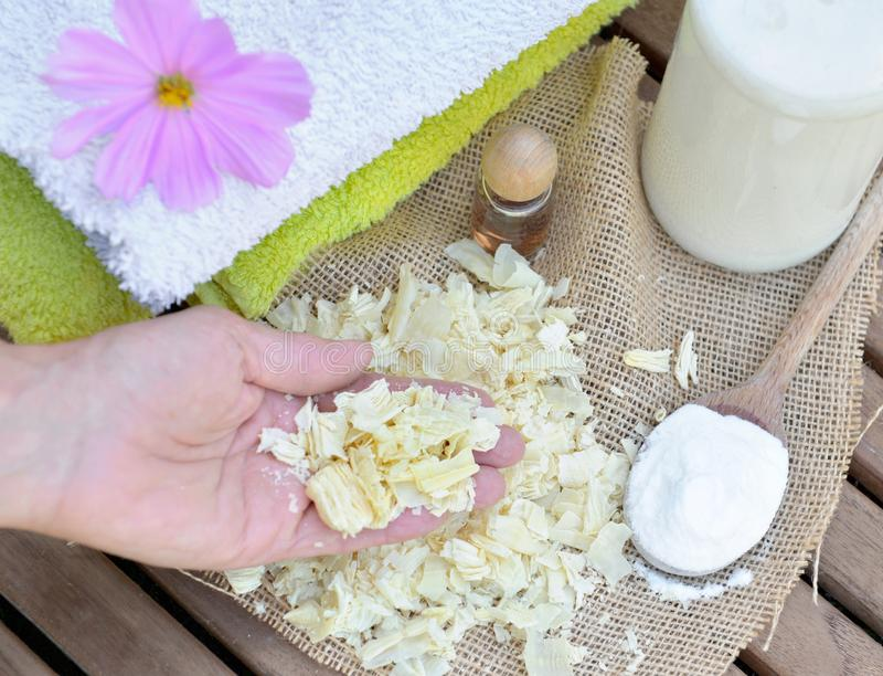 Pieces of soap in a hand  to homemade laundry stock photography