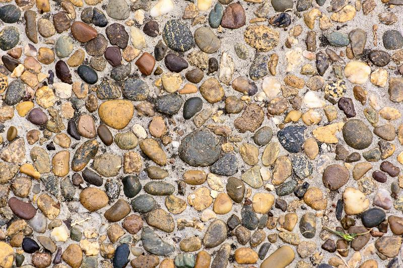 Pieces of stone beside rail track neutral background small pebbles track. Neutral background small pebbles track Pieces of stone royalty free stock images