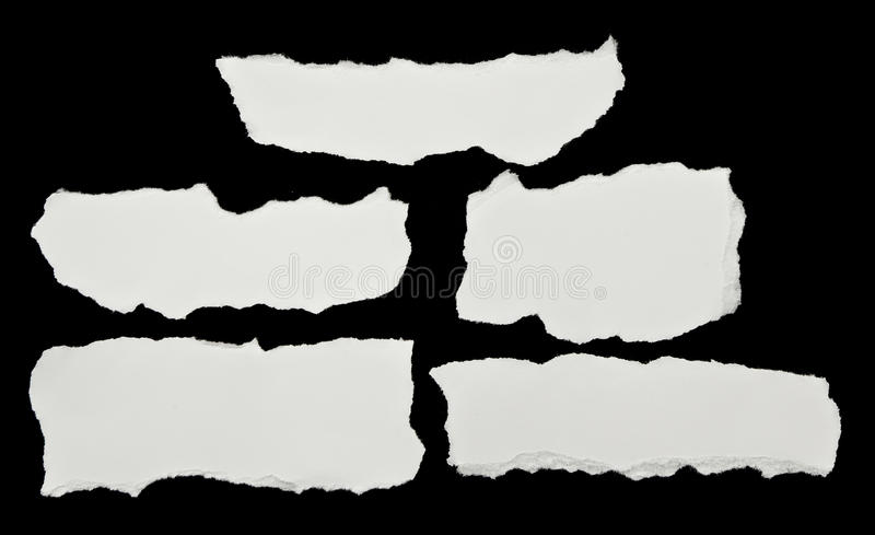 Pieces of torn white paper stock image