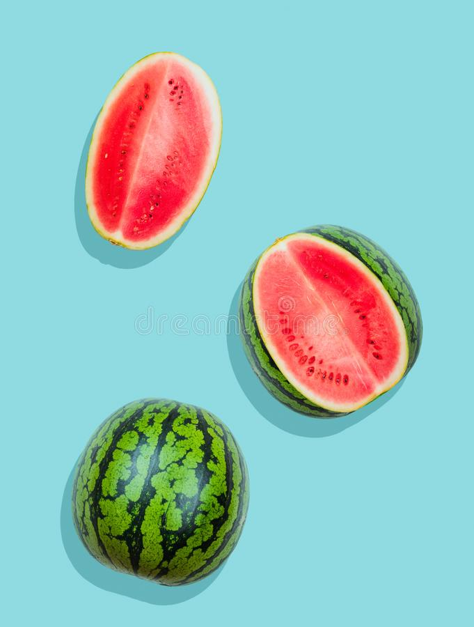 Pieces of watermelon on plain blue background. Fresh watermelon stock photos