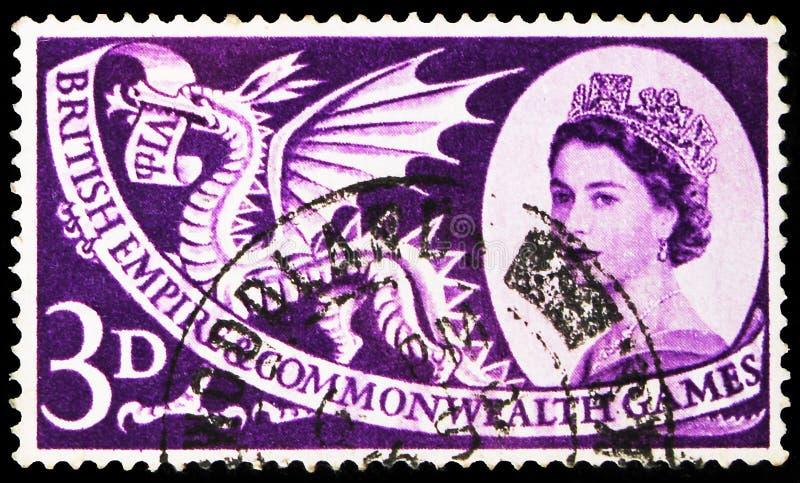 Pieczęć pocztowa wydrukowana w Wielkiej Brytanii pokazuje Welsh Dragon, 3 d - brytyjski penny (stary), Commonwealth Games serie,  zdjęcie royalty free