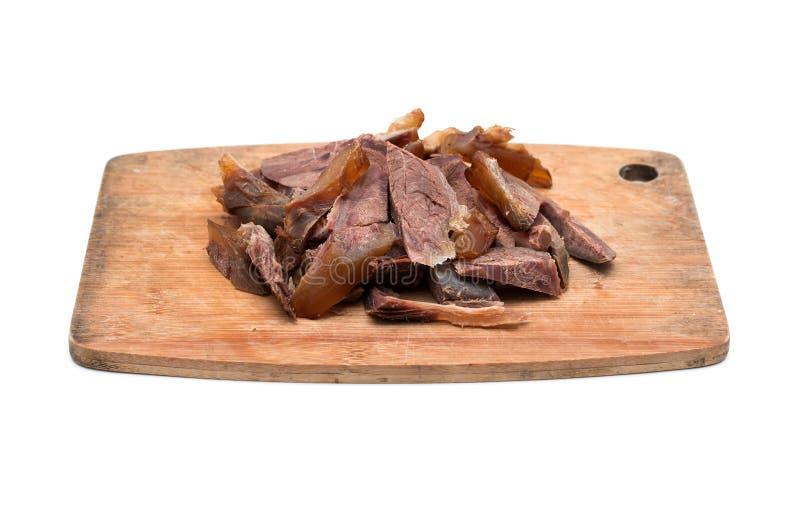 Pieczona wołowina na tnącej desce odizolowywającej na bielu obrazy stock