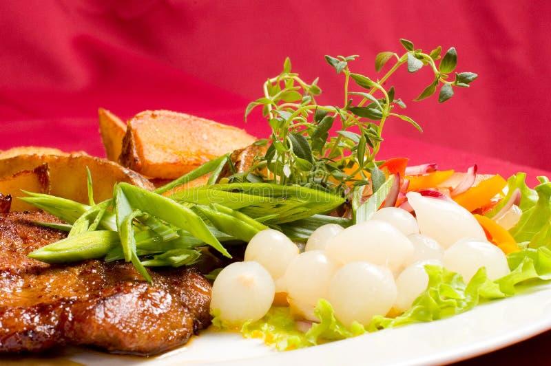 pieczone ziemniaki stek wieprzowych zdjęcie stock