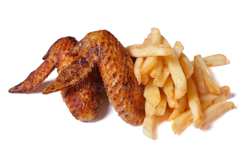 Pieczony kurczak uskrzydla i francuz smaży odosobnionego obrazy royalty free