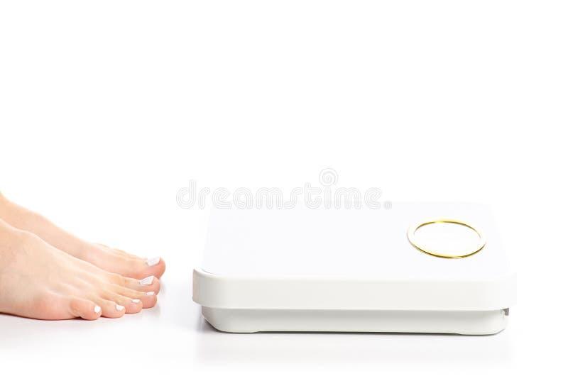 Piedi femminili di bilancia fotografia stock
