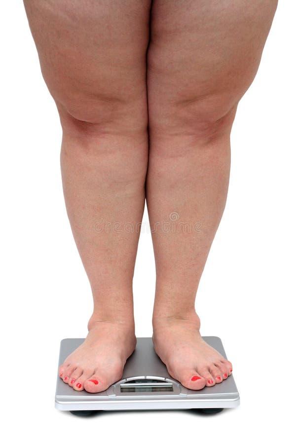 Piedini delle donne con peso eccessivo fotografia stock
