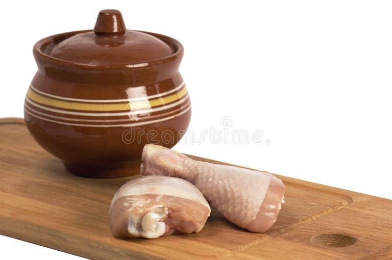 Piedini di pollo su una tabella di legno immagine stock libera da diritti