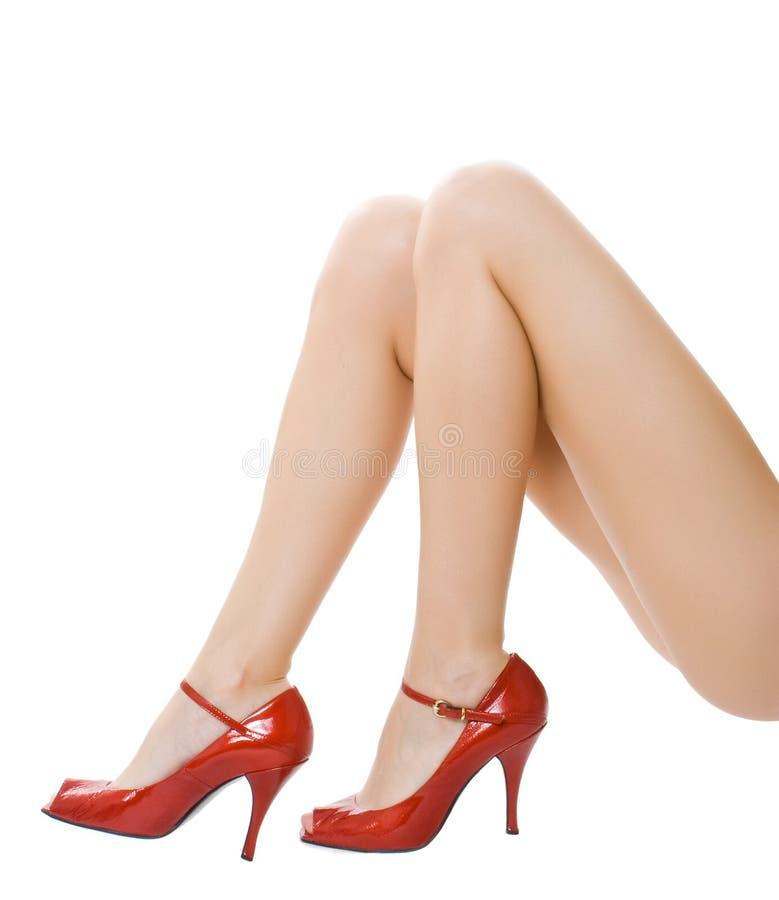 piedini femminili sopra bianco fotografie stock libere da diritti