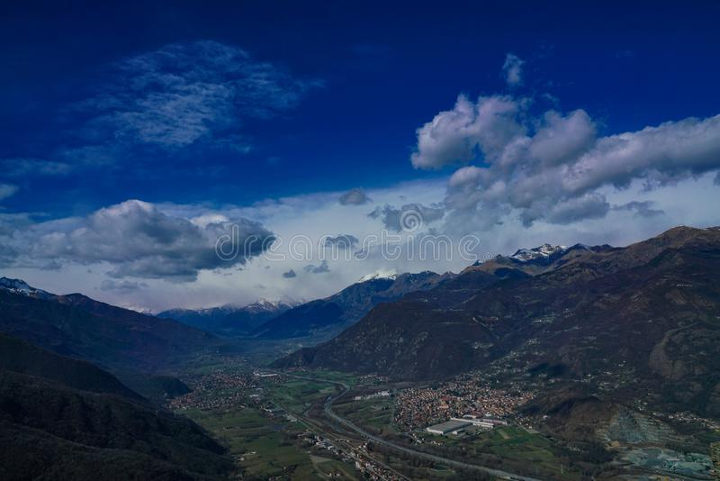 An exceptional view of the Susa valley with blue sky and clouds. Piedmont Italy The Valle di Susa Valsusa in Piedmontese is an Alpine valley located in the stock images