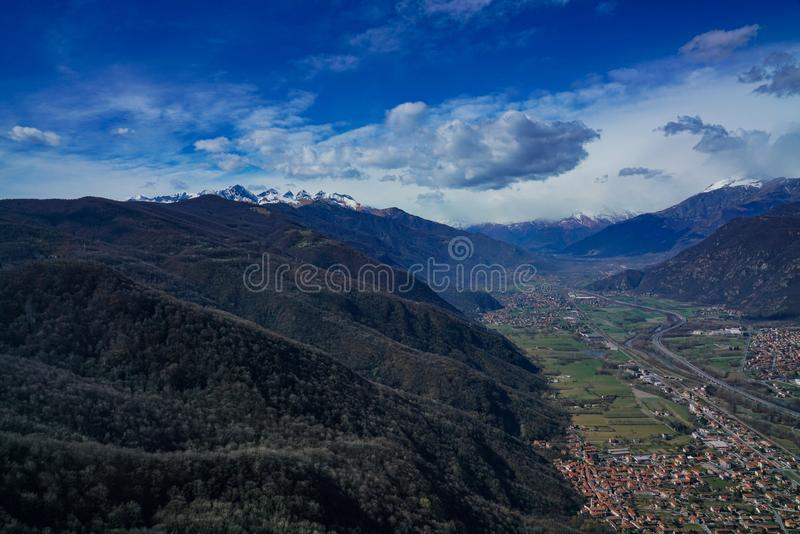 An exceptional view of the Susa valley with blue sky and clouds. Piedmont Italy The Valle di Susa Valsusa in Piedmontese is an Alpine valley located in the stock photography