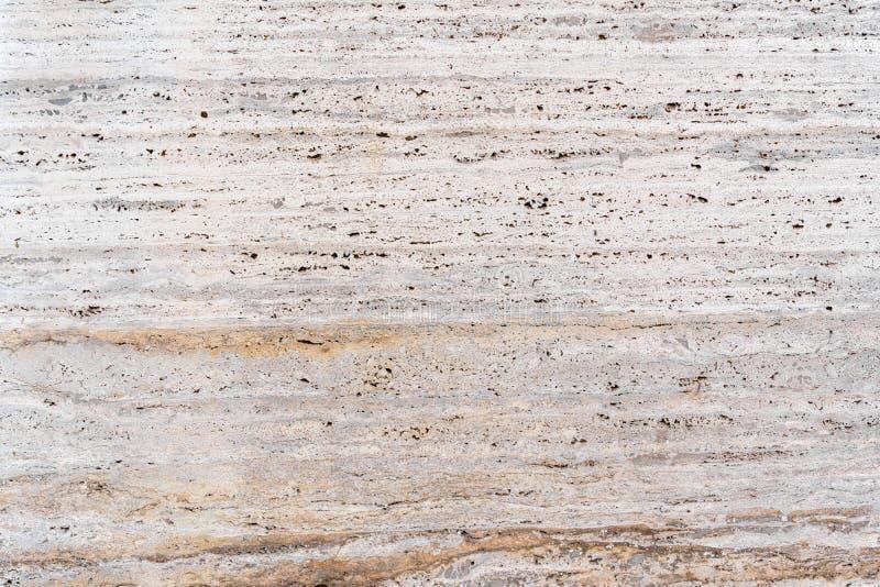 Piedra arenisca rosácea - hacer frente al fondo de piedra de la textura foto de archivo libre de regalías