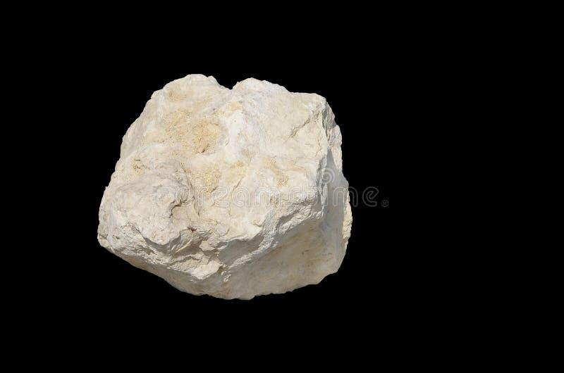 Piedra caliza blanca aislada en negro imagen de archivo libre de regalías