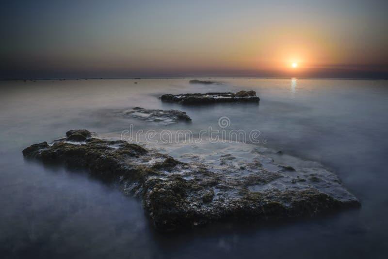 Piedra de la puesta del sol imagen de archivo libre de regalías