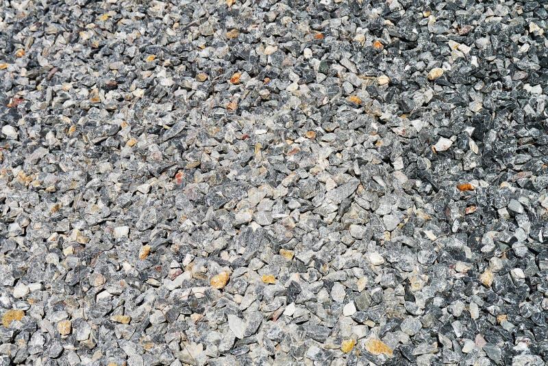 Piedras acometidas materiales fotografía de archivo