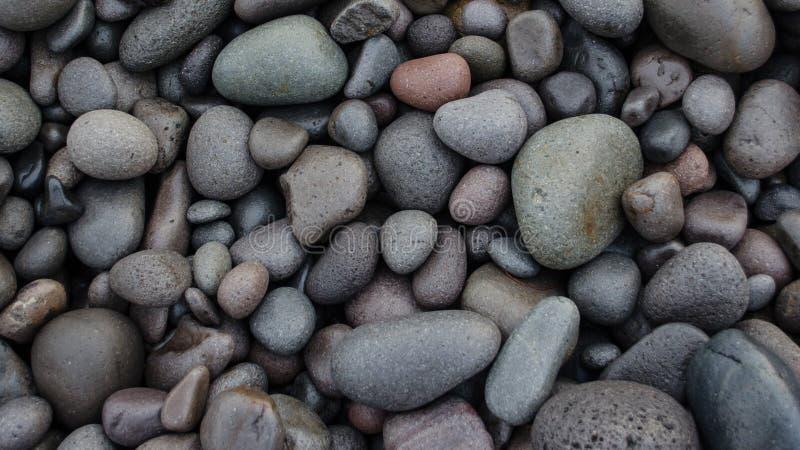 Piedras del mar de diverso fondo de la textura del tamaño imagenes de archivo
