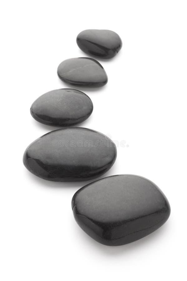 piedras negras del masaje fotografía de archivo
