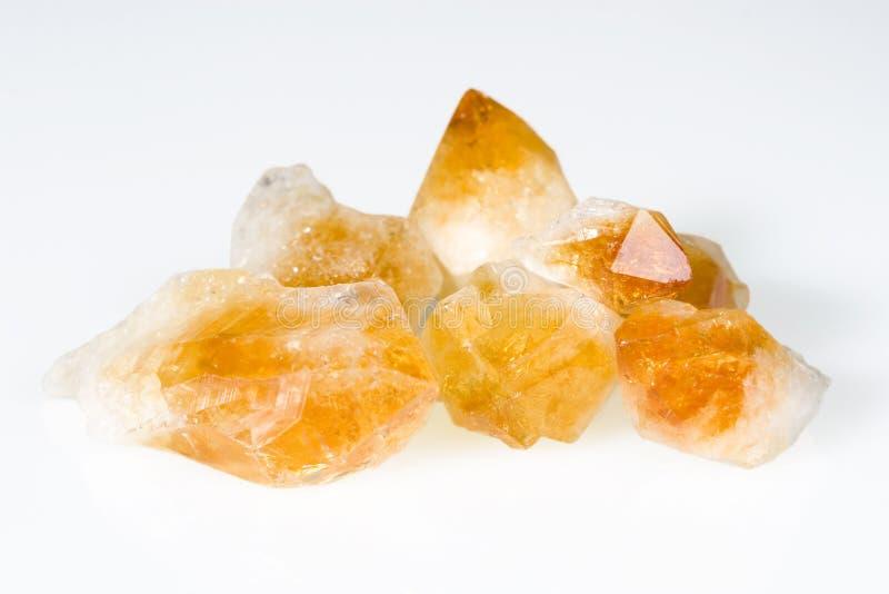 Piedras preciosas citrinas ásperas imagenes de archivo