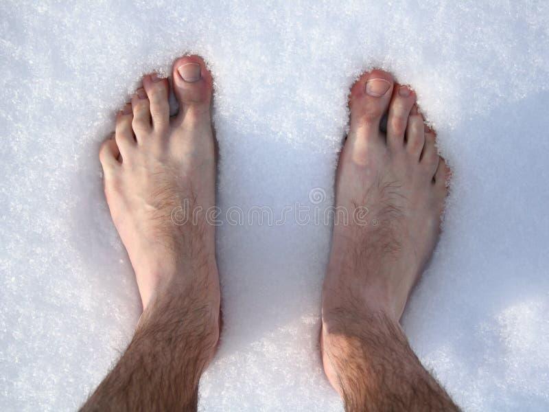 Pieds dans la neige photographie stock