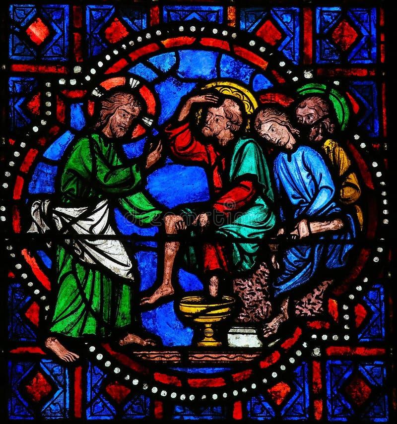 Pieds de lavage de Jésus de St Peter sur le jeudi saint - G souillé images stock