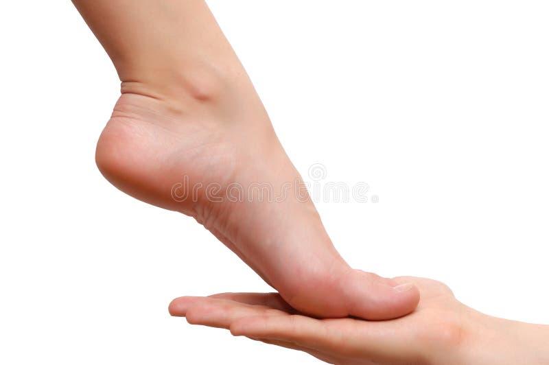pieds de main de femme de l'homme s image stock