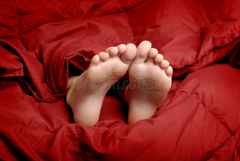 Pieds de sommeil photo libre de droits