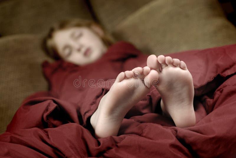 Pieds de sommeil image stock