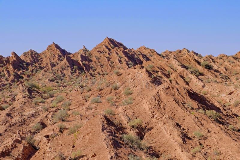 Piegando e colonna esagonale naturale delle montagne, canyon di Cuesta Del Viento, rodeo, San Juan, Argentina fotografie stock libere da diritti