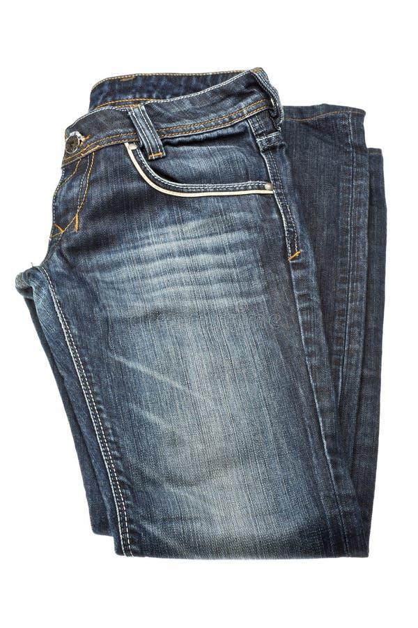Piegato ha strappato i jeans isolati su fondo bianco fotografia stock