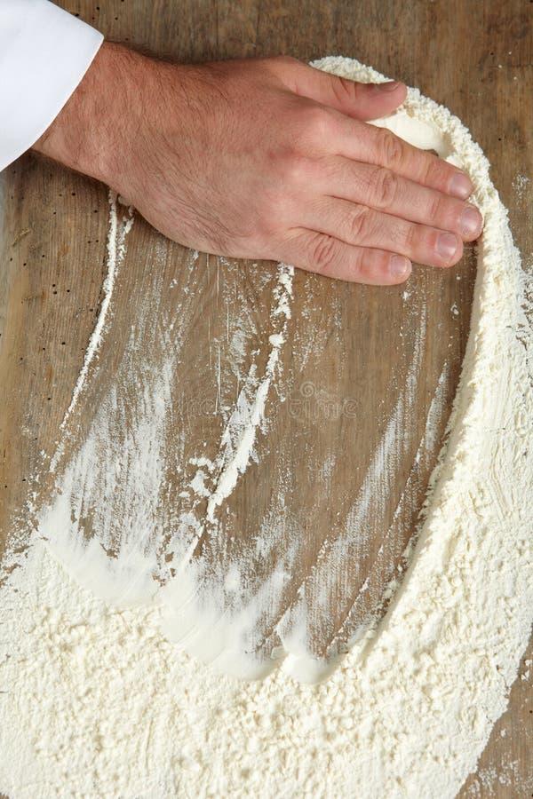 piekarz ręka zdjęcia stock