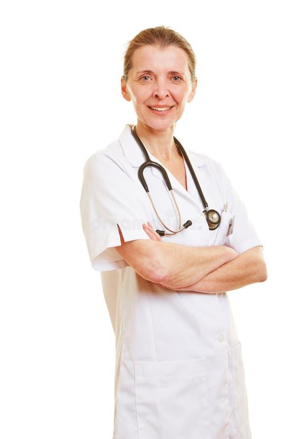 Pielęgniarka z jej rękami krzyżować zdjęcia royalty free
