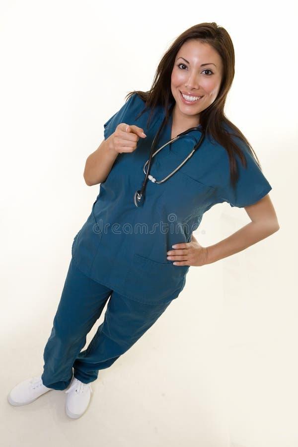 pielęgniarki wskazać szczęśliwy obraz stock