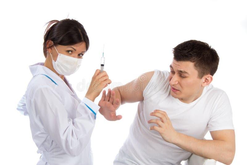Pielęgnuje strzykawki igłę i obsługuje strasznego wtryskowy szczepienia phob zdjęcia stock