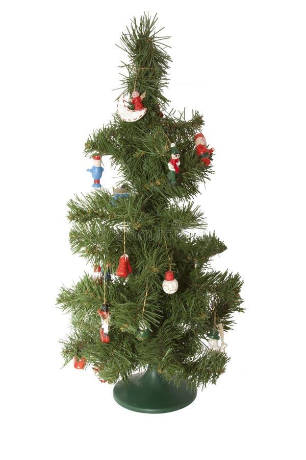 Piel-árbol artificial de la Navidad con los juguetes imagen de archivo