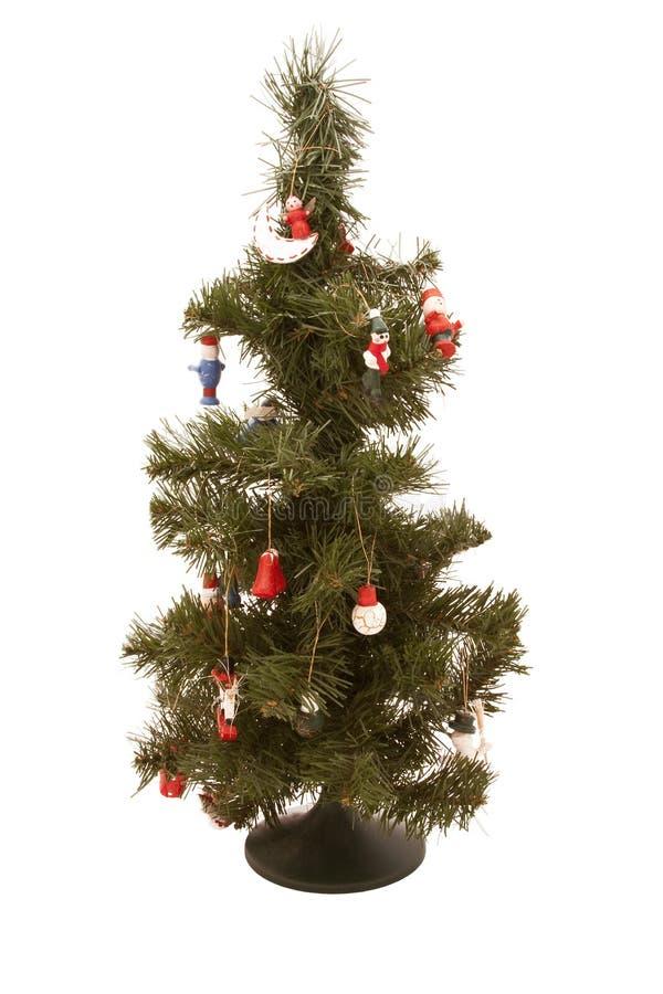 Piel-árbol artificial de la Navidad con los juguetes imagenes de archivo