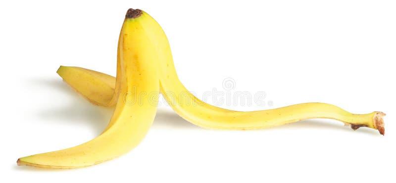 Piel de plátano deslizadiza en un fondo blanco imágenes de archivo libres de regalías