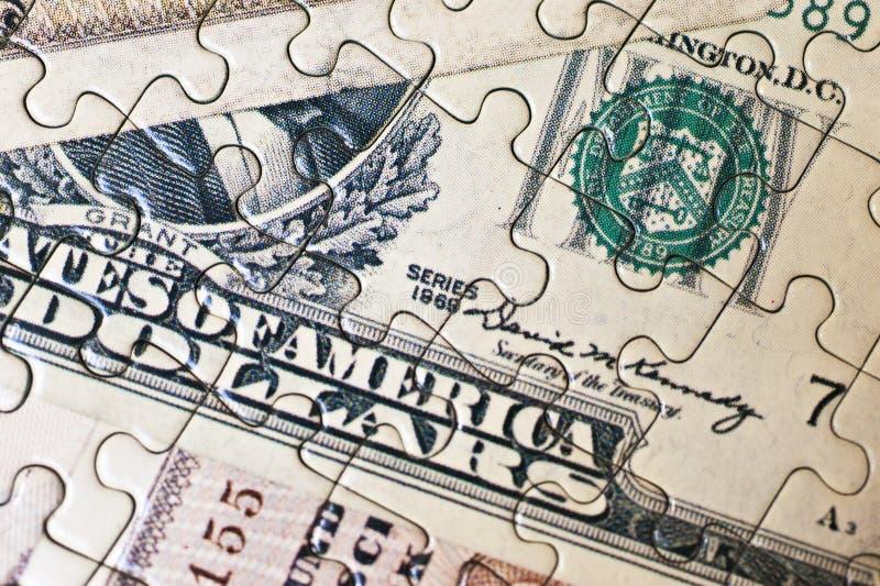 Pieniądze łamigłówka obraz stock