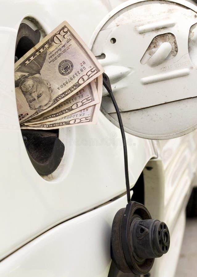 pieniądze benzynowy zbiornik zdjęcie royalty free