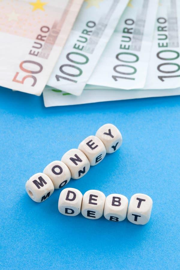 Pieniądze dług - Crossword łamigłówka obrazy stock