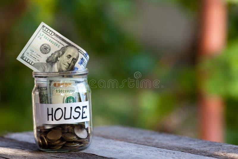 Pieniądze dla domu w butelce obraz royalty free