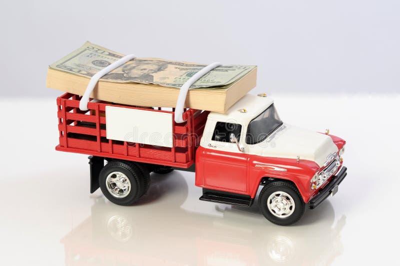 pieniądze góry ciężarówka sterty pickup obrazy stock