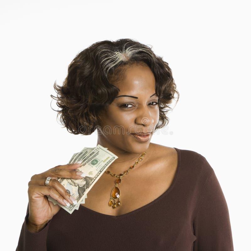 pieniądze gospodarstwa kobieta obrazy royalty free
