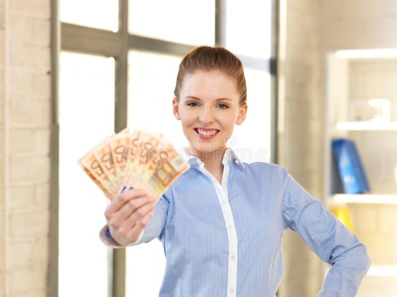 pieniądze gotówkowa euro urocza kobieta zdjęcia stock