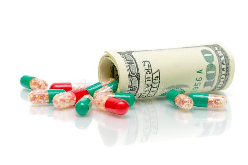 Pieniądze i medyczni leki na biały tle obrazy stock
